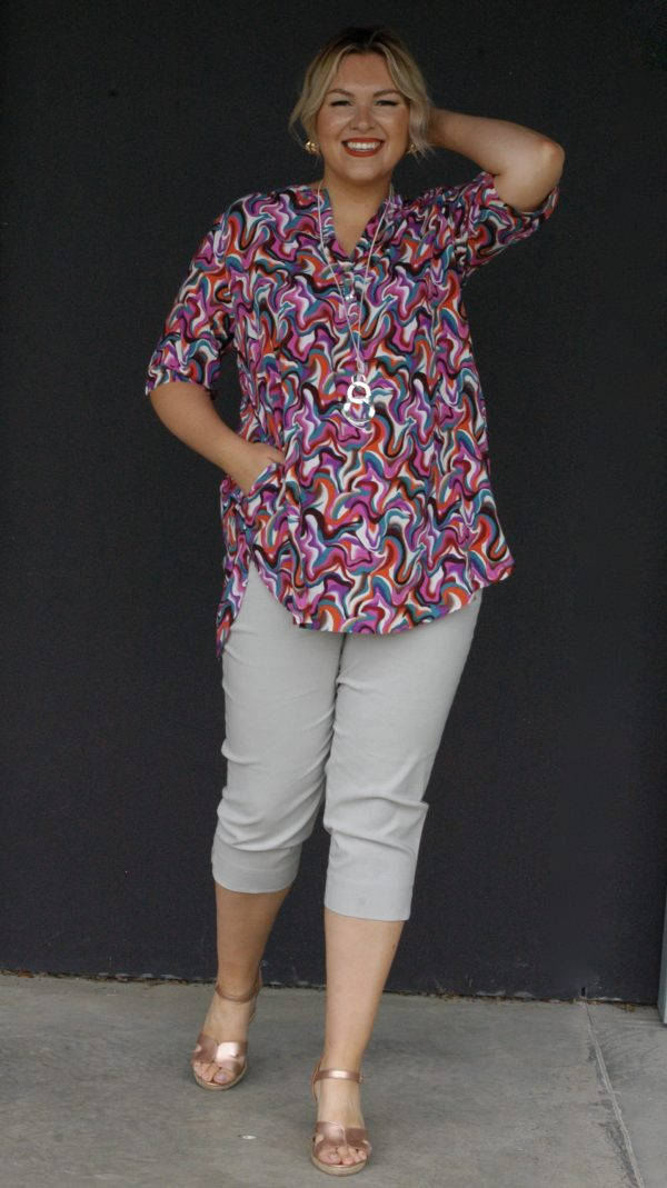 Model is wearing Tansy retro print tunic by Kasbah Clothing