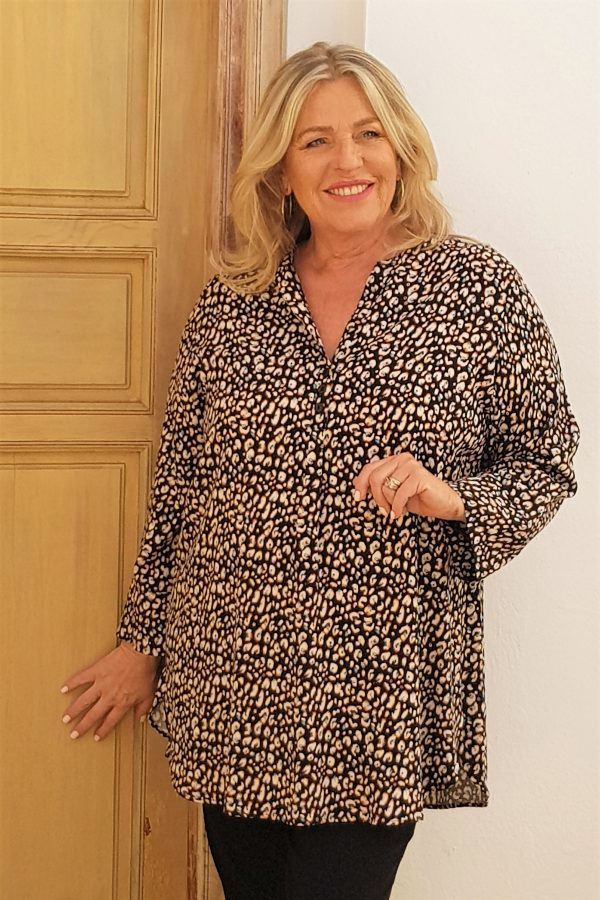 Model is wearing Tulip Cheetah print button tunic by Kasbah Clothing