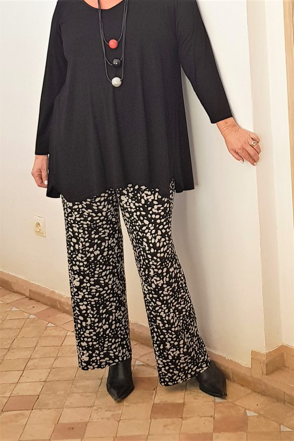 Model is wearing Priya jersey patterned palazzos by Kasbah Clothing