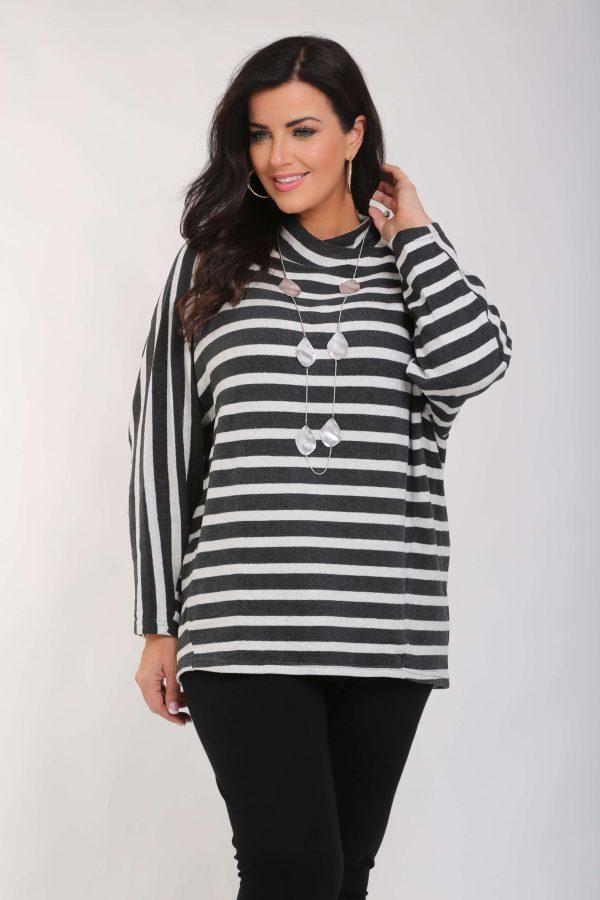 Model is wearing cotton stripe batwing top by Vetono