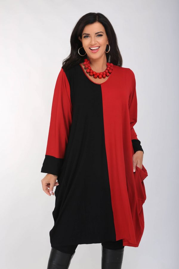 Woman is wearing 2 tone pocket dress tunic in Red and Black by Angel Circle
