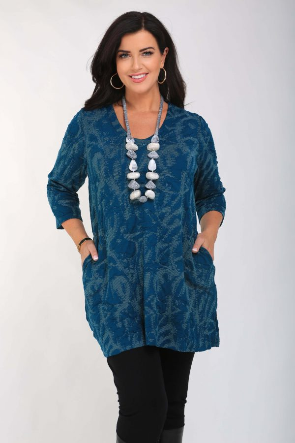 Model is wearing Pont Neuf Melina stretch tunic in petrol