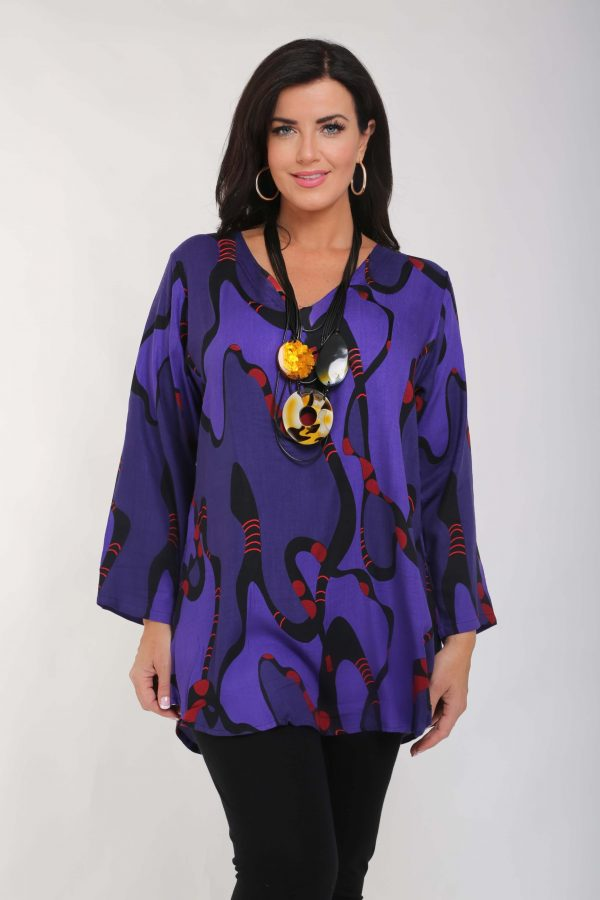 Model is wearing V neck tunic in purple by Angel Circle
