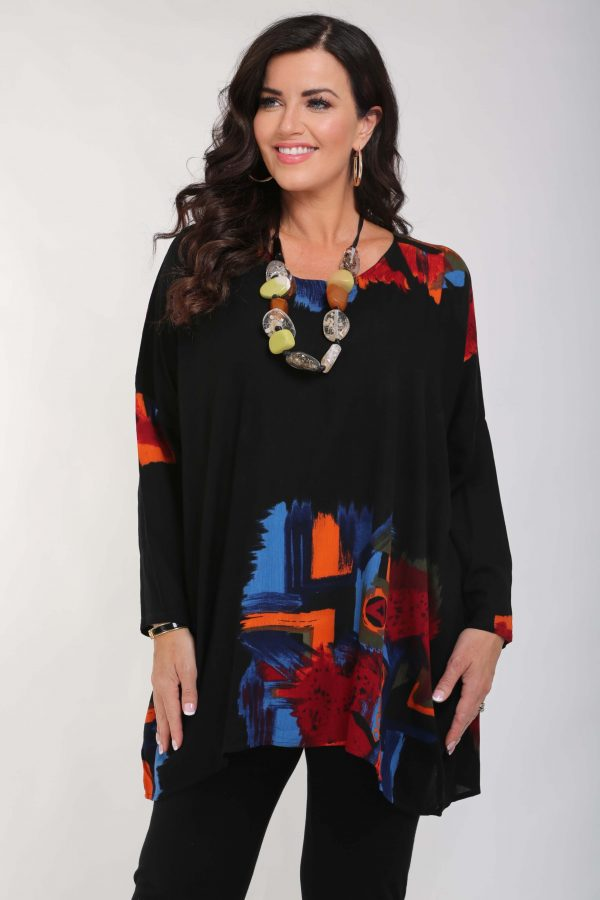 Woman is wearing Angel Circle batwing oversize tunic in black and multicolour