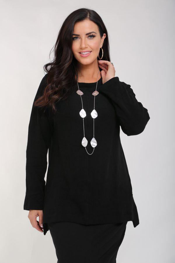 Woman is wearing Vetono soft cotton stretch tunic in black