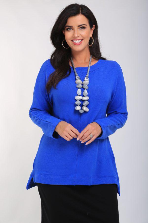 Woman is wearing cobalt plain soft cotton stretch knit tunic by Vetono