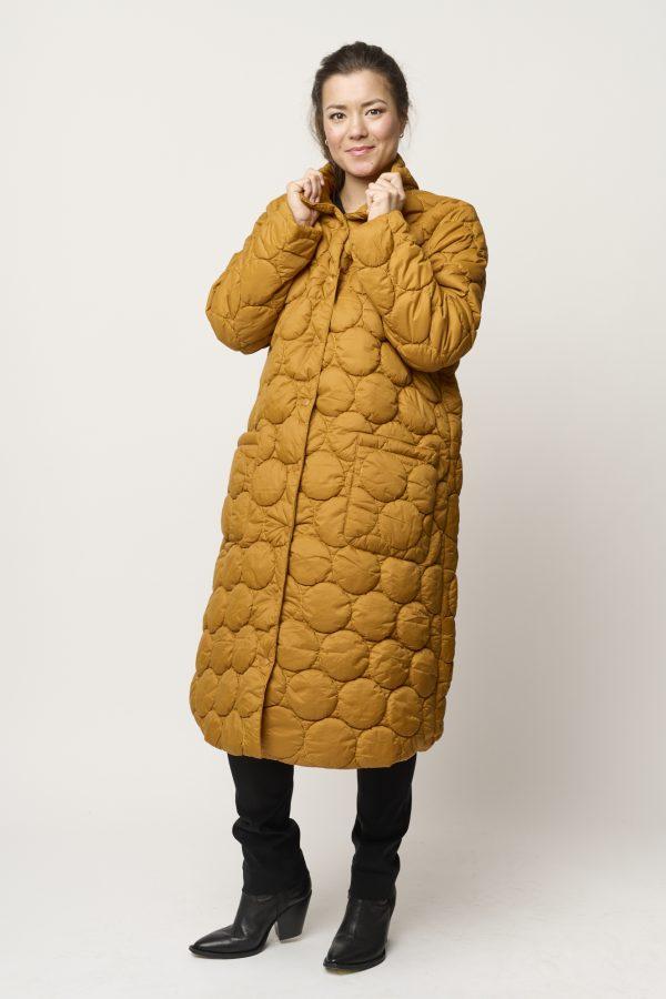 Model is wearing Cobina coat in caramel by Pont Neuf