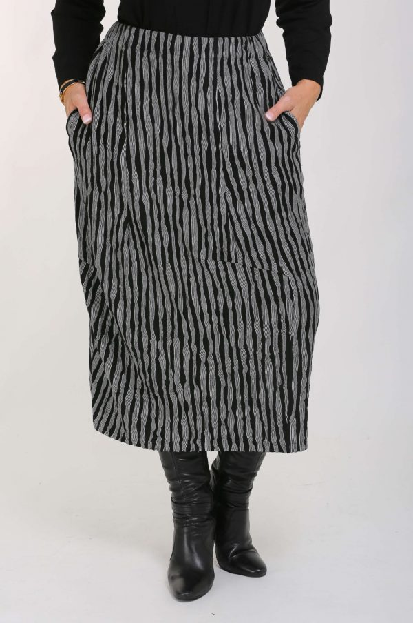 Model is wearing jersey crinkle skirt in black and white by Vetono