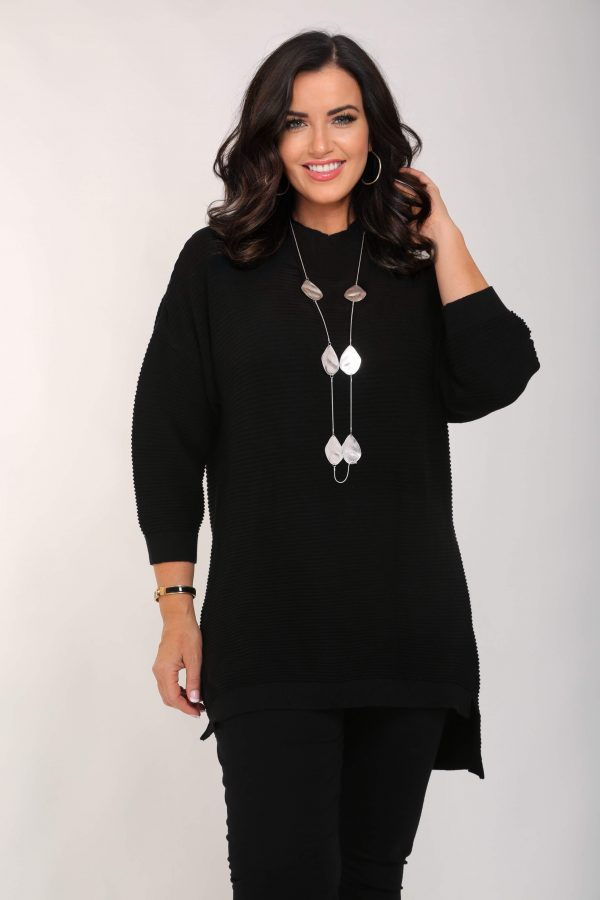 Woman is wearing long cottton ribbed jumper dress in black from Orientique